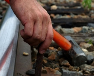 1a-taking-railroad-spike_000008415936_Small
