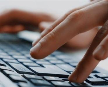 1c-man-typing-498064389