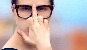 10a-woman-adjusting-glasses-middle-finger-488509330